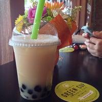 Photo taken at Green Cup Cafe by Viviane K. on 5/31/2016
