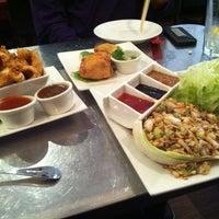 Photo taken at EAT = Authentic Thai Kitchen by Wilson X. on 1/16/2013
