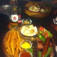 Photo taken at Kelari Beerhouse by Christina P. on 10/23/2013