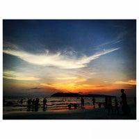 Photo taken at Pantai Cenang (Beach) by Ajim A. on 4/20/2013