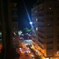 Photo taken at Orla de Copacabana by Alexândre R. on 12/27/2013