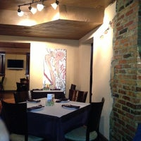 Photo taken at Still Worldly Eclectic Tapas by Elaine S. on 11/17/2012