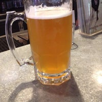 Photo taken at Rogue Ales Public House & Brewery by Jennifer W. on 9/25/2014