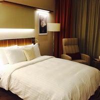 Photo taken at Novosibirsk Marriott Hotel by Alexey K. on 10/22/2014