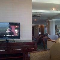 Photo taken at Garuda Indonesia Executive Lounge by Shaka O. on 12/18/2012