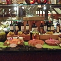 Photo taken at Braza Leña Brazilian Steakhouse by janet f. on 1/12/2014