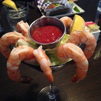 Photo taken at The Blu Crab Seafood House & Bar by Jenn A. on 3/7/2014