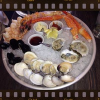 Photo taken at High Tide Seafood Bar & Grill by Lisa on 3/23/2014