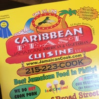 Photo taken at Caribbean Feast Cuisine by Lee B. on 5/24/2014