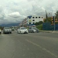 Photo taken at Traffic Light Likas by Imelda M. on 11/17/2012