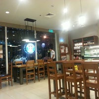 Photo taken at Starbucks Coffee by Mark Lester C. on 2/16/2013