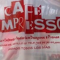 Photo taken at Cafe Impresso by fontorres on 9/29/2012