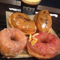 Photo taken at DISTRICT. Donuts. Sliders. Brew. by Kevin O. on 10/26/2013