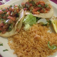 Photo taken at Mangos Mexican Café by Caryn K. on 4/11/2014