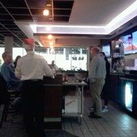 Photo taken at Courtside Restaurant & Cafe by www.CoachVtennis.com C. on 12/19/2012