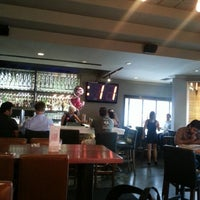 Photo taken at Earls Restaurant by Aysun I. on 7/18/2014
