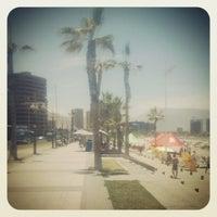 Photo taken at Playa Cavancha by Ernesto Javier C. on 1/6/2014
