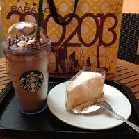 Photo taken at Starbucks by KunG S. on 12/14/2012