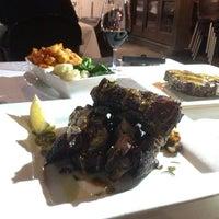 Photo taken at Sosta Argentinian Kitchen by Jodie H. on 8/30/2013