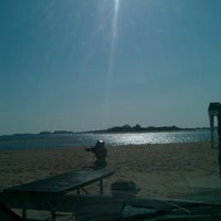 Photo taken at Clinton Beach by Charley S. on 4/5/2013
