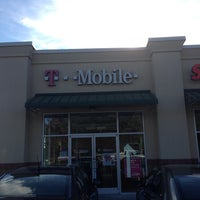 Photo taken at T-Mobile by Marcus M. on 9/28/2013