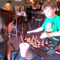 Photo taken at Jitterbug Coffeehouse by Alicia A. on 6/26/2014