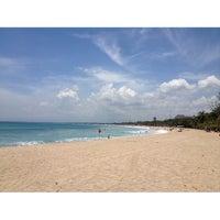 Photo taken at Kuta Beach by Jiaxin on 10/22/2013