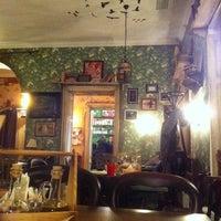 Photo taken at Propaganda Café by Alina C. on 12/19/2013