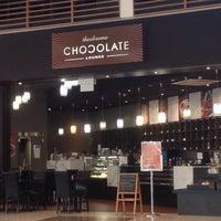 Photo taken at Theobroma Chocolate Lounge by Doug W. on 2/26/2014