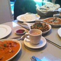 Photo taken at Taste of India by Jenn H. on 10/14/2012