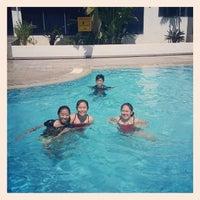 Photo taken at Swimming Pool Likas Square by Daros K. on 12/23/2013