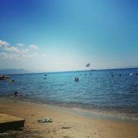 Photo taken at Kılıç Beach Club by Mert S. on 8/18/2015