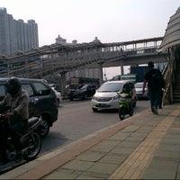 Photo taken at Halte TransJakarta S Parman Podomoro City by Ichwan H. on 10/22/2013