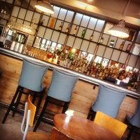 Photo taken at Sam's Brasserie & Bar by Monica Y. on 5/19/2013