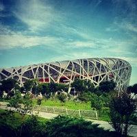 Photo taken at National Stadium (Bird's Nest) by Thomas M. on 6/17/2013