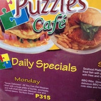 Photo taken at Puzzle Cafe by Arlyn L. on 12/22/2012