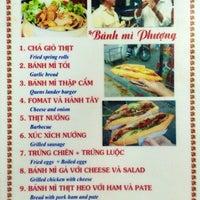 Photo taken at Bánh Mì Phượng by Nic M. on 6/8/2014
