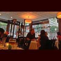 Photo taken at Mon Petit Café by Anthony L. on 7/20/2013