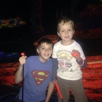 Photo taken at Putting Edge Glow-in-the-Dark Mini Golf by Mike E. on 12/24/2013