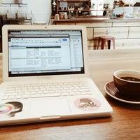 Photo taken at Andante Coffee Roasters by Klarika H. on 4/18/2014