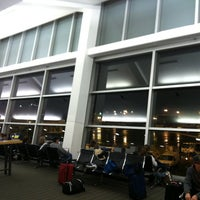 Photo taken at Gate A5 by Marcus G. on 12/27/2012