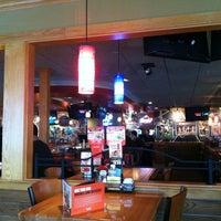 Photo taken at Applebee's Neighborhood Grill & Bar by Marcus G. on 4/4/2013