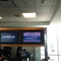 Photo taken at Gate 7 by Esteeb L. on 4/4/2014