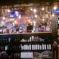 Photo taken at Floyd's 99 Barber Shop by john on 12/21/2012