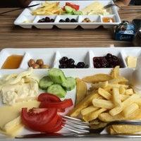 Photo taken at Mutfak(Cafe&Restaurant) by Çiğdem S. on 8/9/2014