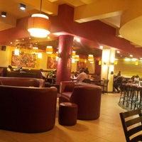 Photo taken at Nairobi Java House by Teri on 12/31/2012