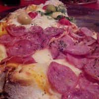 Photo taken at Baggio Pizzeria & Focacceria by Carlos L. on 12/22/2013