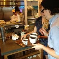 Photo taken at Artifact Coffee by Greg N. on 6/18/2013