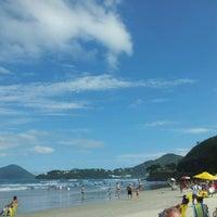 Photo taken at Praia Grande by Juliana P. on 3/31/2013