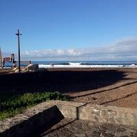 Photo taken at chamopoint beach by Ali Alejandro C. on 2/4/2014